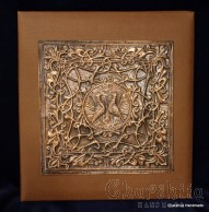 Photo album in brown artificail leather, decorated with aluminum plate with floral ornaments
