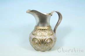 Silver and gilt Jug with ornaments
