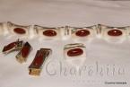 Сребърен комплект от четири части с Kарнеол