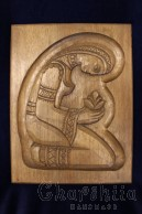 "Woodcarving ""Girl with a flower"""