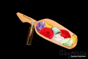 Souvenir wooden spoon with а small perfume bottle from bulgarian rose 'Damascena'
