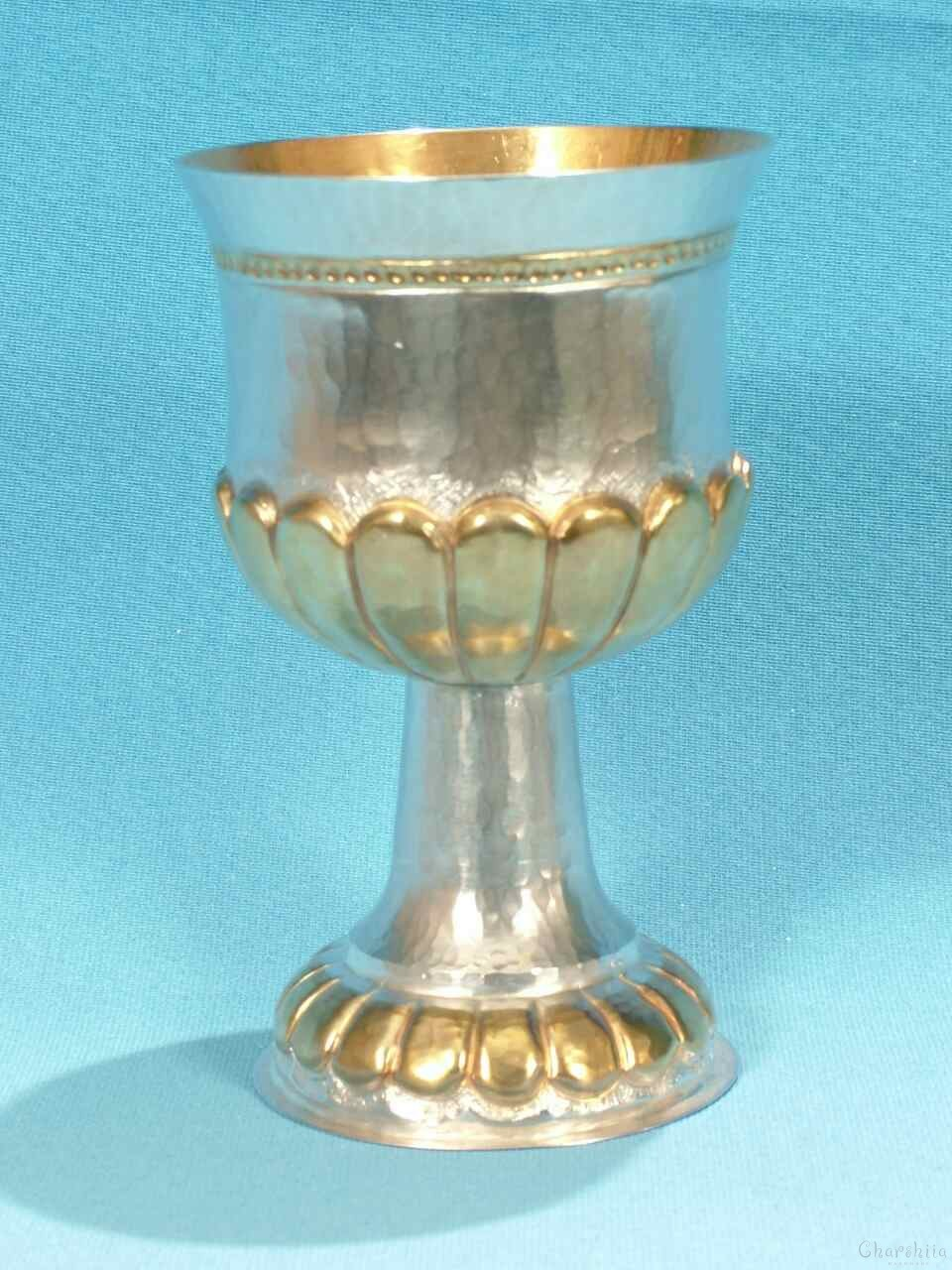Silver and gilt cup with ornaments