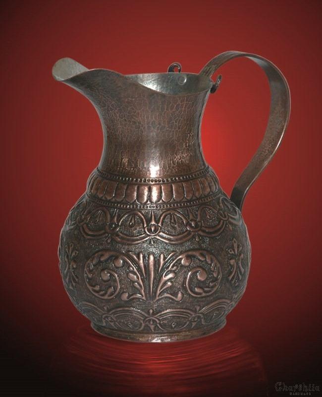 Copper releif jug with traditional Bulgarian patterns