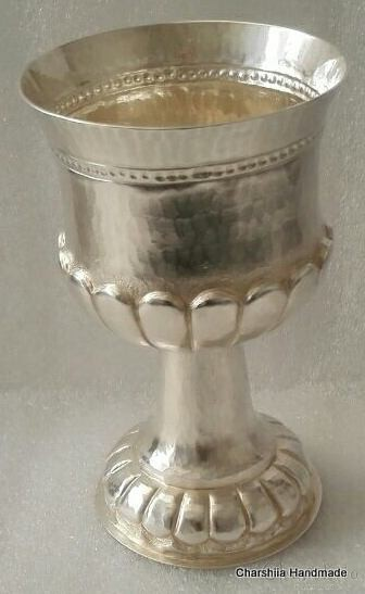 Silver cup with ornaments