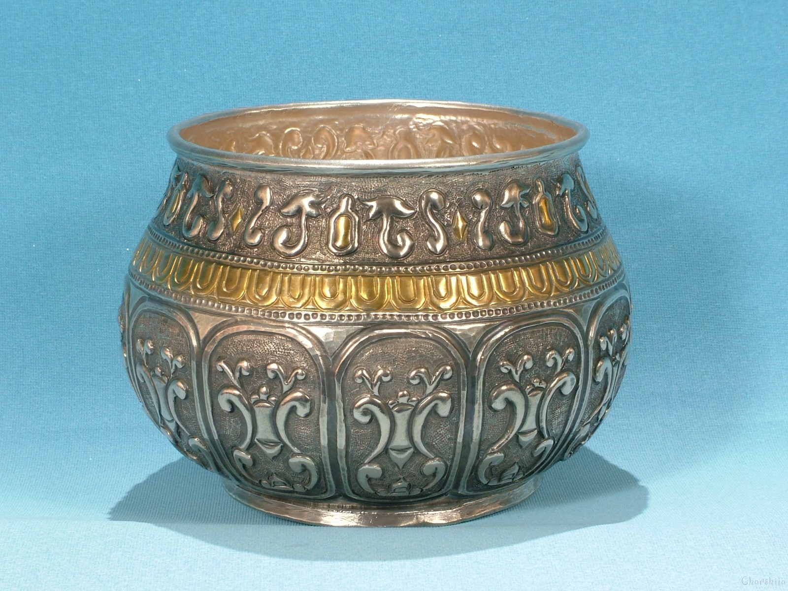 Copper relief bowl/Bratina - silver and partially gold-plated.