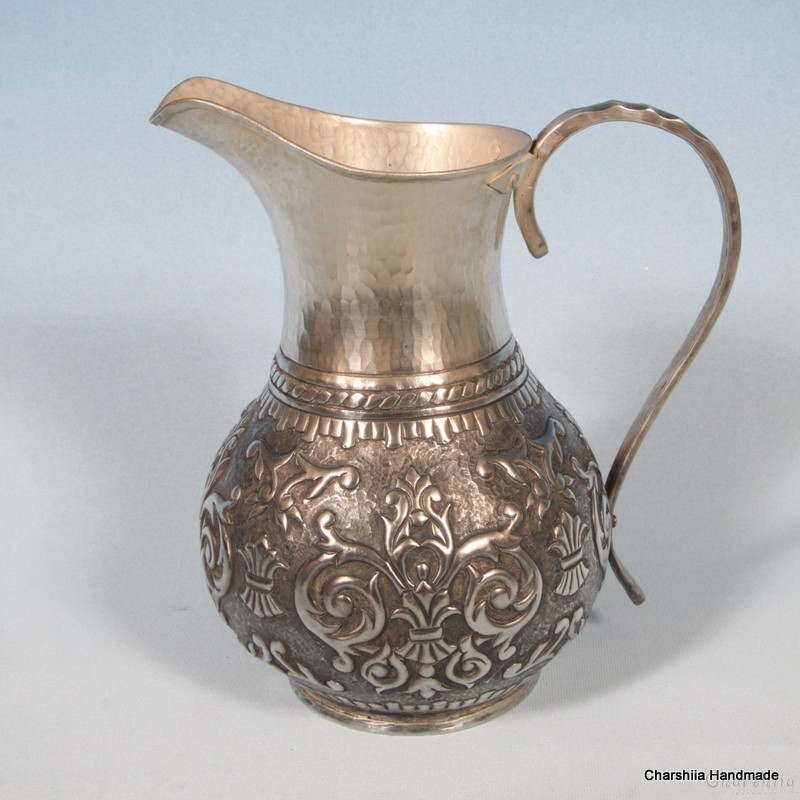 Copper relief, silver coated jug
