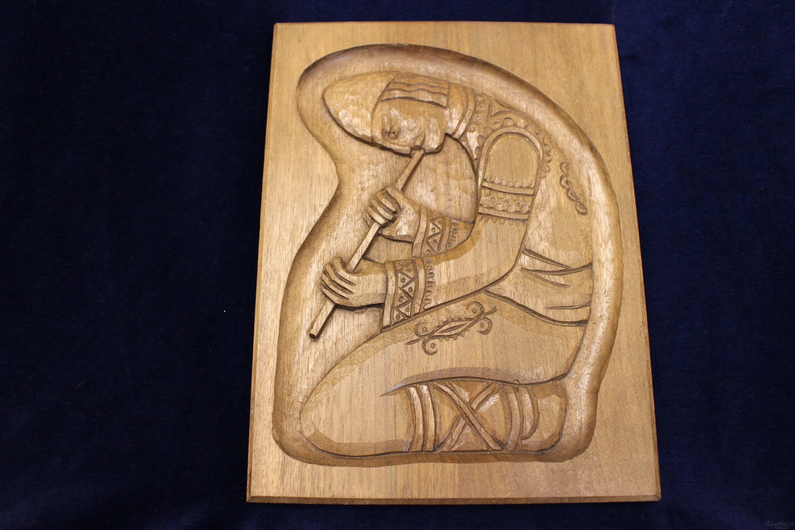 "woodcarving ""Boy with flute"""