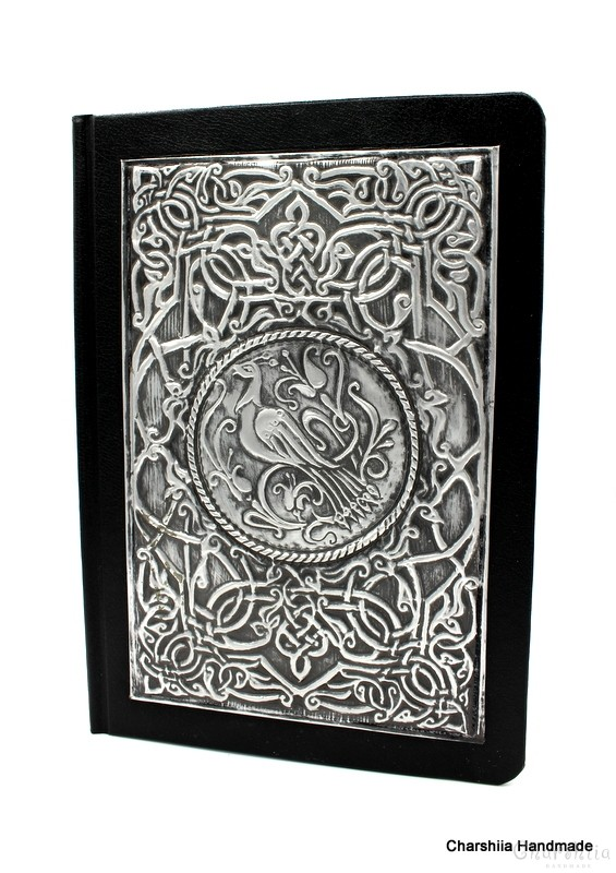 Notebook dressed in black artificail leather, decorated with aluminum plate with floral ornaments