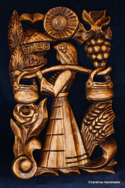 """Woodcarving """"Woman with kobilica"""""""