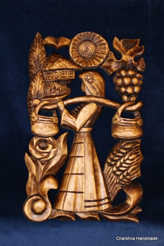 "Woodcarving ""Woman with kobilica"""
