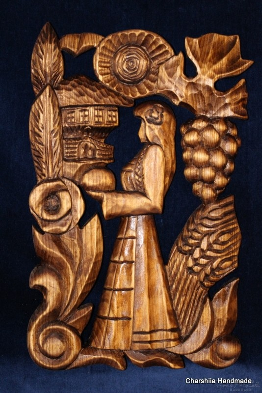 "Woodcarving ""Woman with ritual bread"""