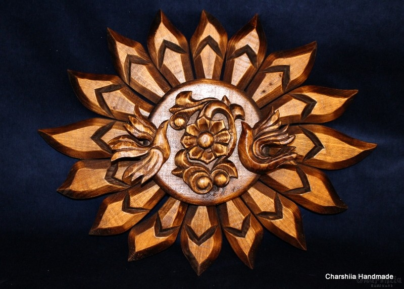 "Woodcarving ""Sun, birds, flower"""