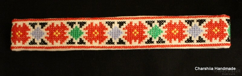 Women's metal belt buckle with a hand embroidered belt
