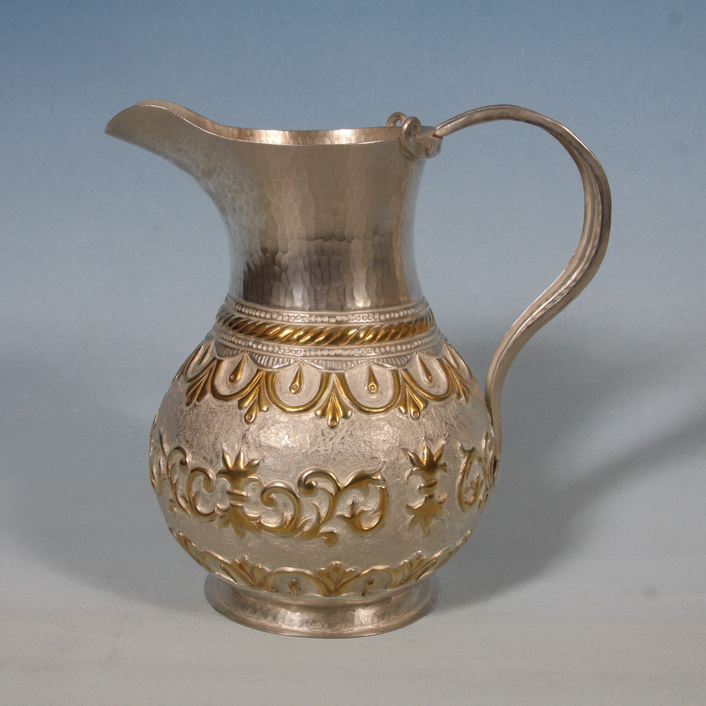 Silver and gilt Jug with ornaments 2