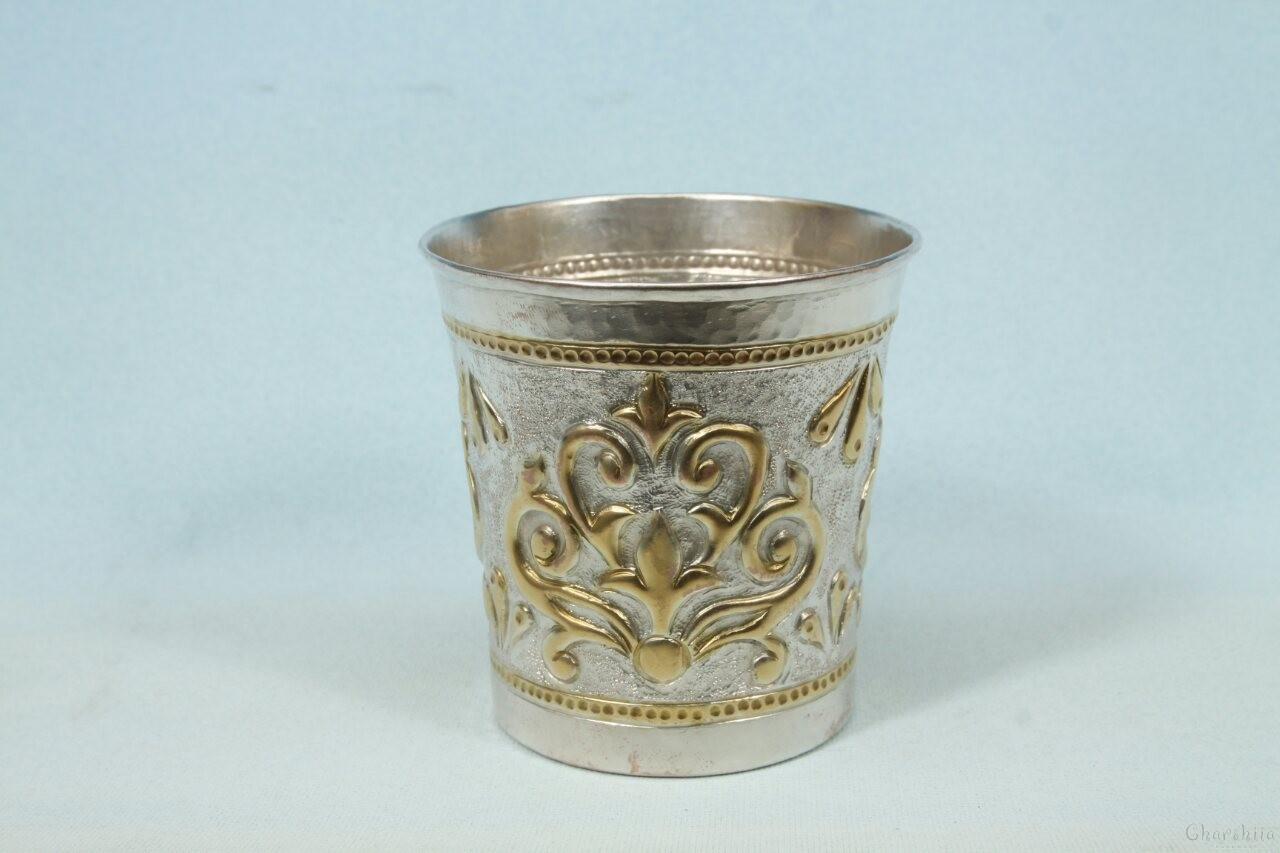 Silver and gilt cup with ornaments 3